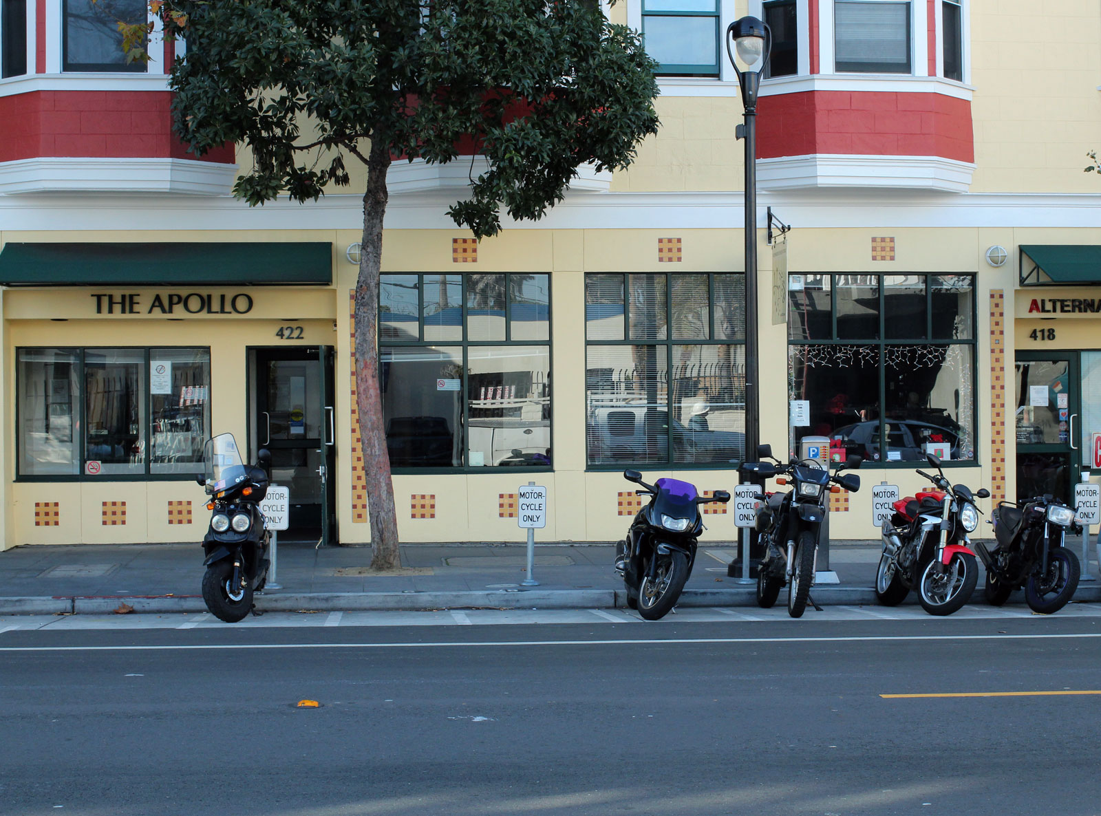 A motobike sits apart from three others