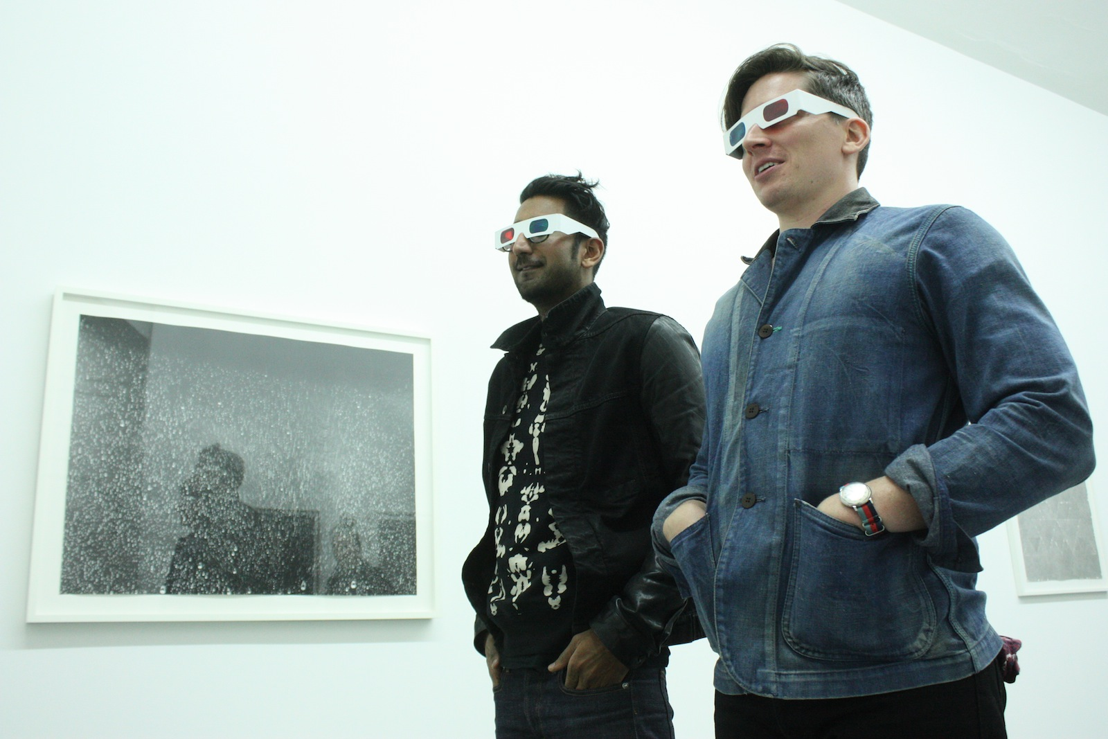 Two visitors wearing 3D glasses.