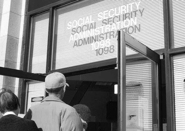A line of some 30 people finally files into the Social Security Administration building on Valencia at 9 a.m.