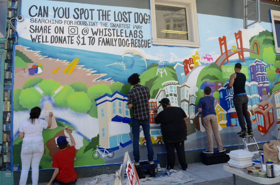 Sirron Norris and helpers finishing up a mural