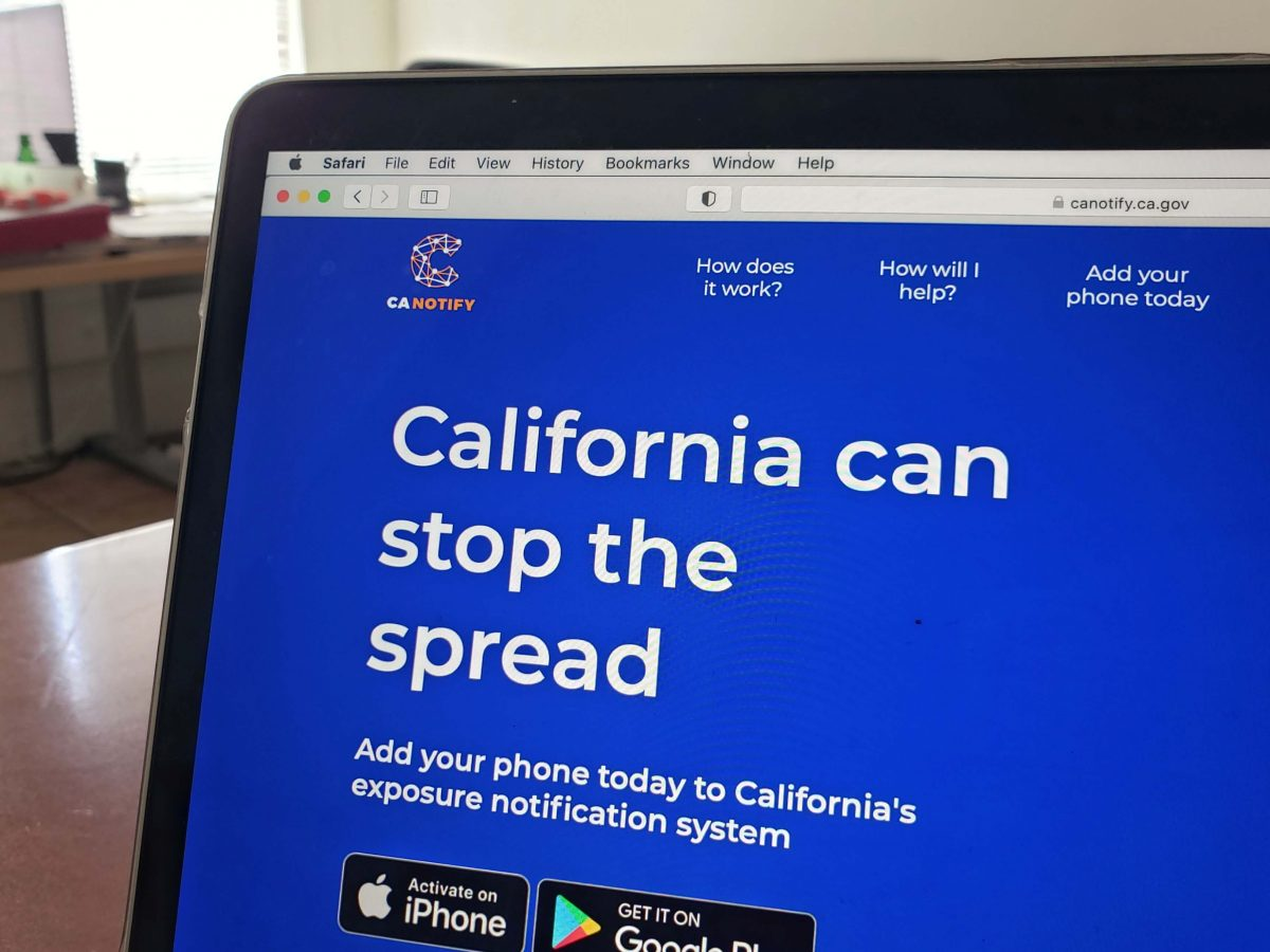 CA Notify's website on a laptop. Mission Local. April 2021.
