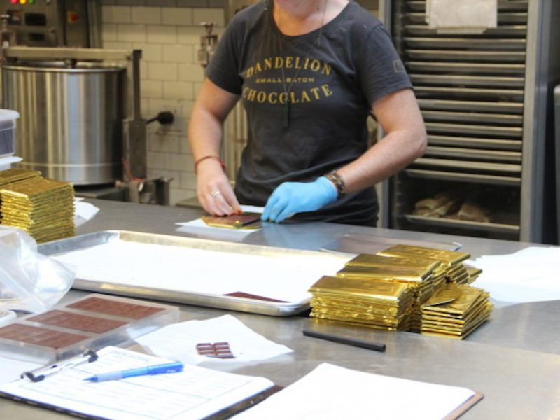 The chocolate is hand-wrapped in golden foil before being machine-wrapped in specially-made Indian paper. After that, it's labeled and sent out to retailers nationally and internationally. Photo by Joe Rivano Barros.