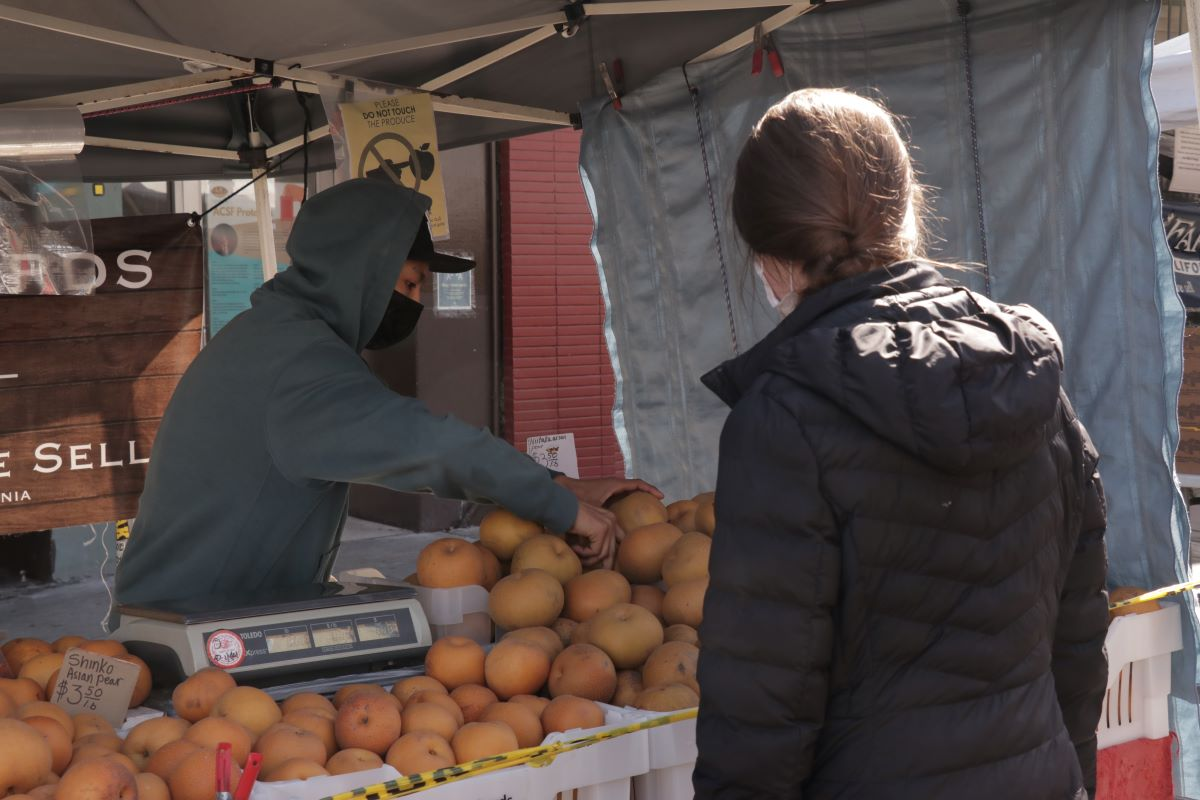David Liu, from K&J Orchards, at the Mission Community Market.