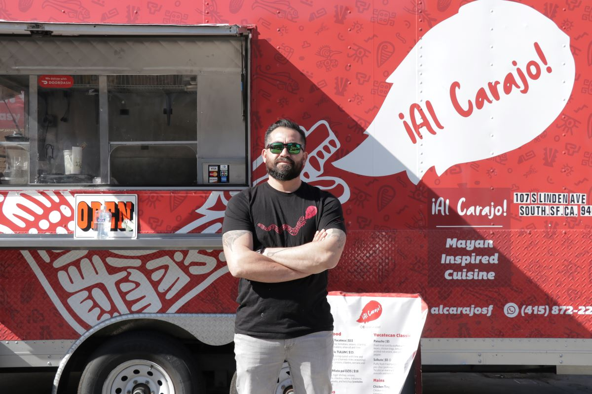 Javier Leon poses in front of his Al Carajo truck.