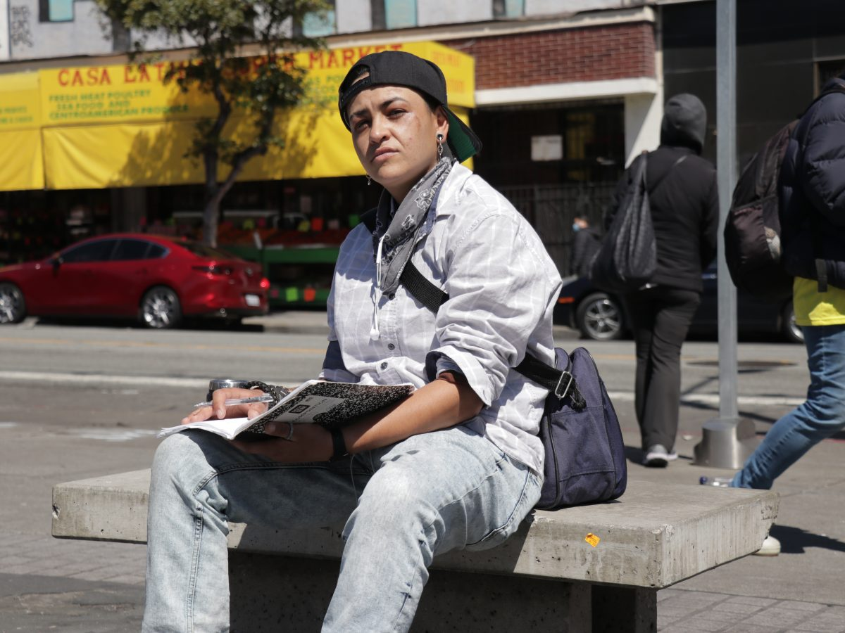 Herlinda Huerta sits at a bench at the 16th and Mission streets BART Station
