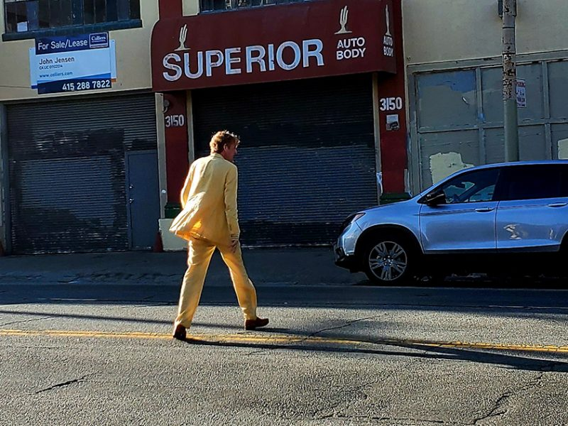 A man in a yellow suit.