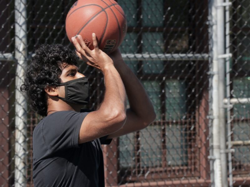 Suraj Menon shoots hoops at Mission Playground.