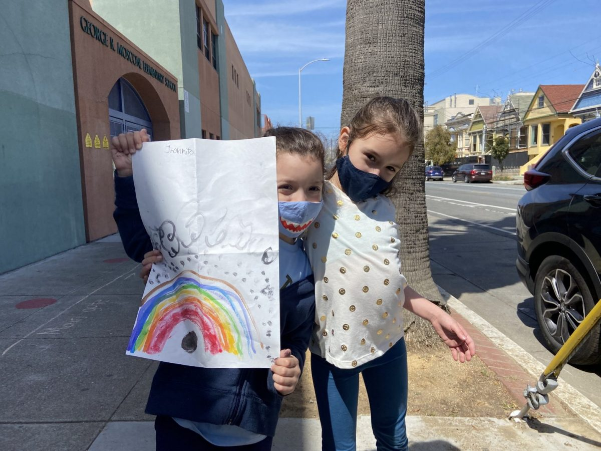 Jhonnathan Dalmadi, 6, and his sister Teresa Dalmadi, 8, show off Jhonnathan's drawing of a rainbow that he made on the first day of school at George Moscone Elementary School.