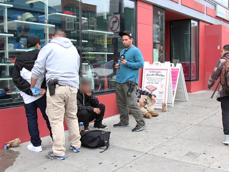 Men detained on 19th and Mission, 2018. Photo by Abraham Rodriguez.