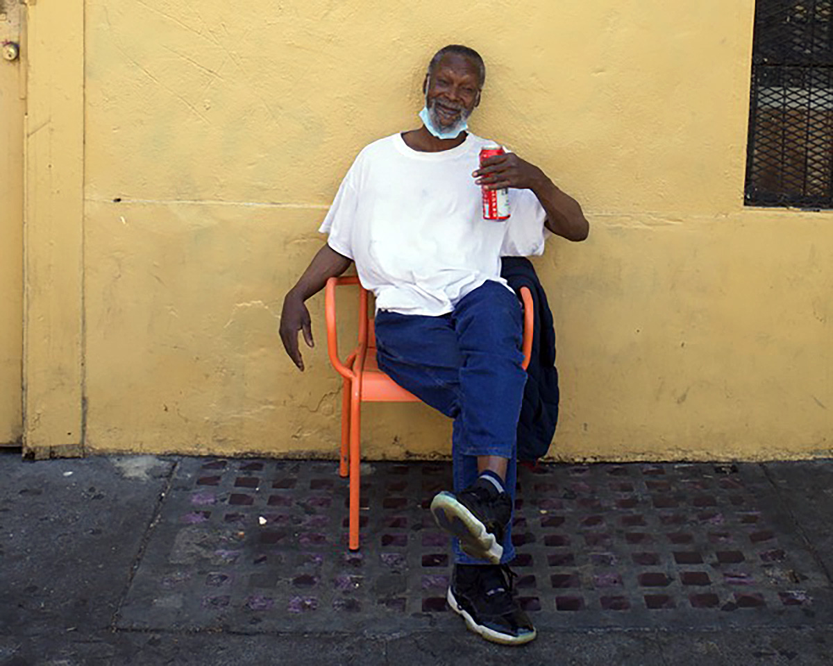 Man in an orange chair on 16th Street