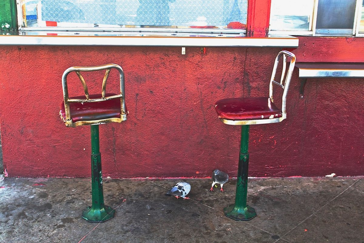 Two empty chairs at Whiz Burer
